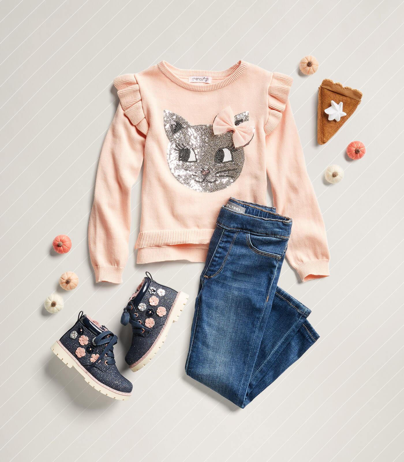 cat sweatshirt and jeans