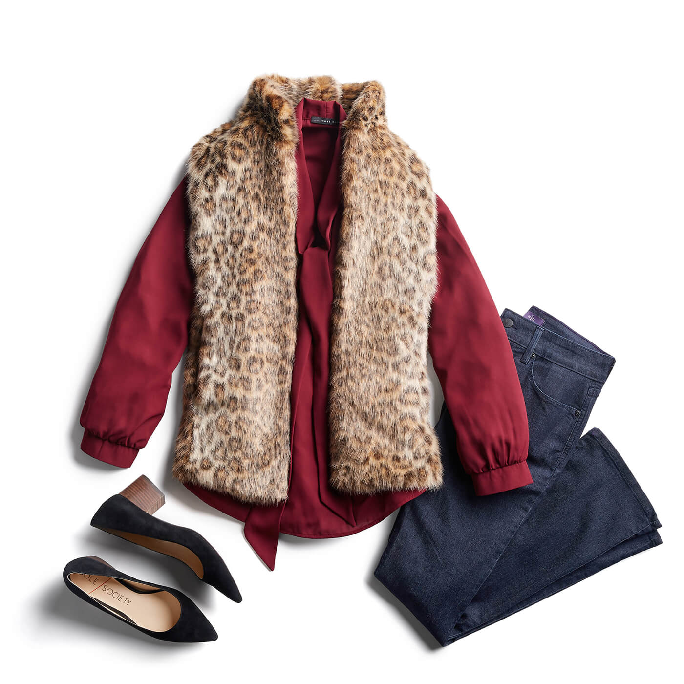 fur vest and dark wash jeans